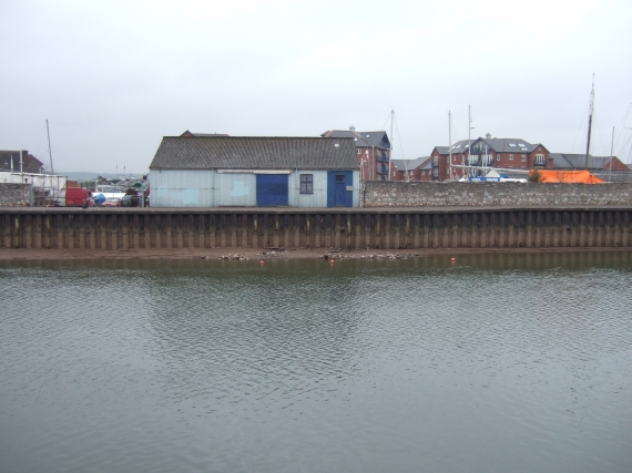 Quayside office, Exeter, and river with low flow