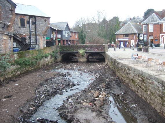 Stream bed, former leat, Exeter quay with road bridge