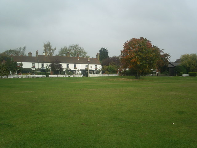 The Two Brewers pub at Chipperfield with part of Chipperfield common in foreground