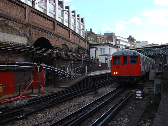 A Metropolitan line train departs from Farringdon