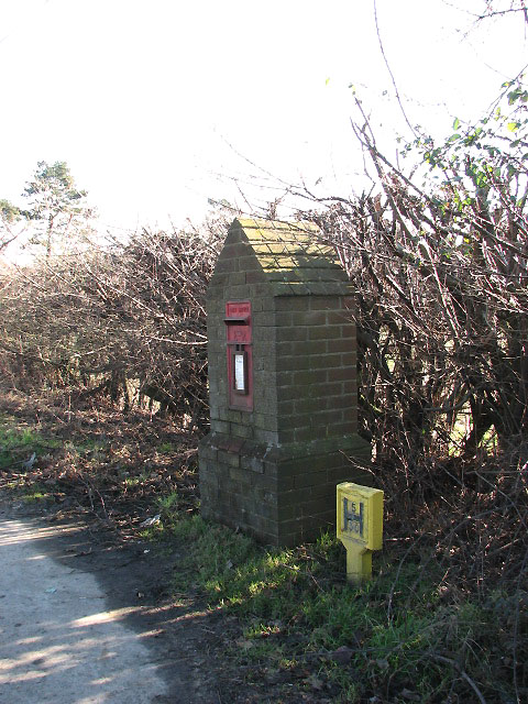 Postbox encased in brick