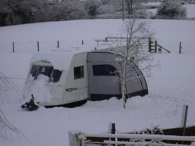 Caravan in the snow at Birch Hill Farm Caravan Club CL