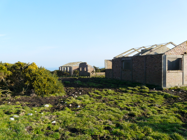 Old wartime buildings on the clifftop