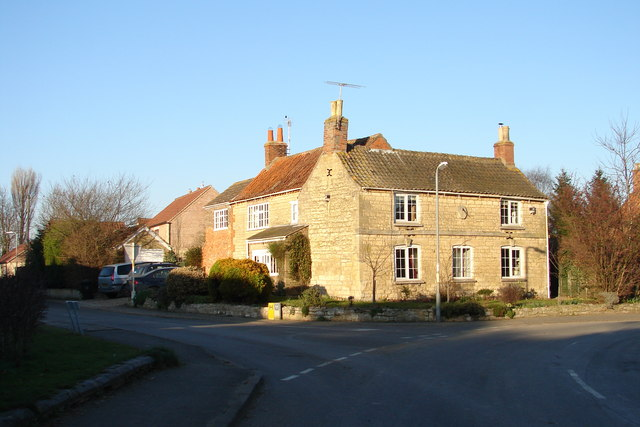 House in Horbling with Sundial