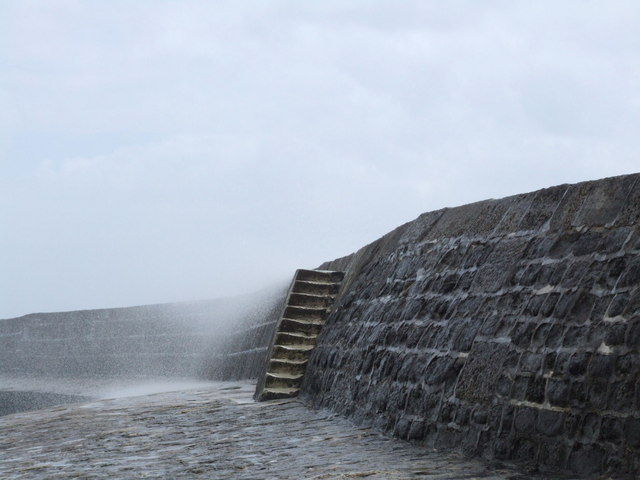 Spray breaking over The Cobb at Lyme Regis