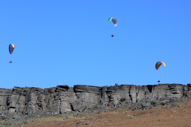 Paragliders above Stanage Edge