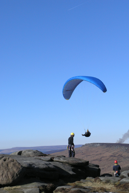 Two climbers and a para-glider