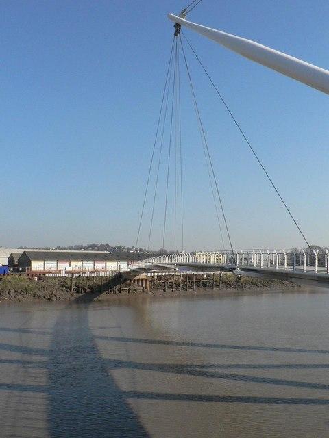 Newport: bridge shadow crosses river