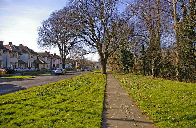 Footway along Houndsden Road, London, N21, looking west.