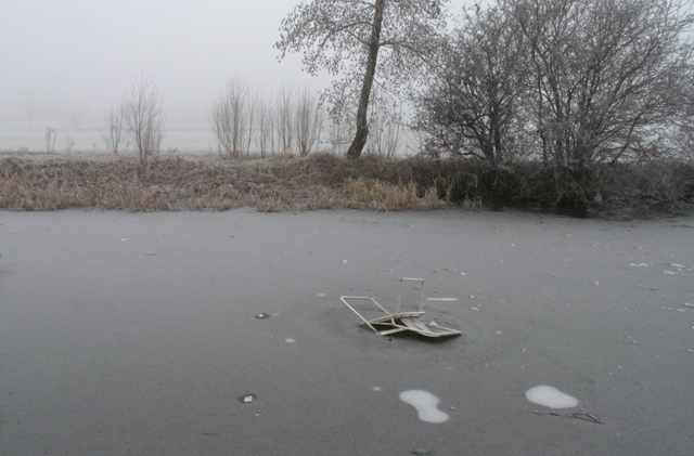 Chair and frozen canal