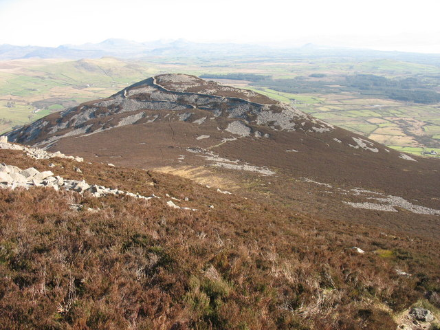 The scree strewn slopes of Yr Eifl descending to the col which separates it from Tre'r Ceiri