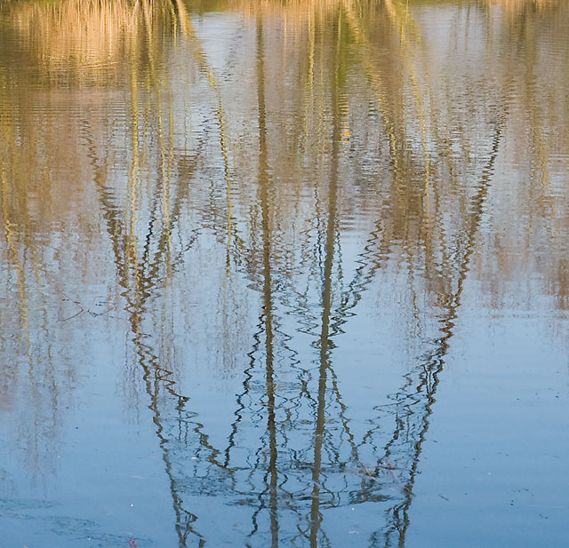 Reflection of pylon in Broadlands Lake, Nursling