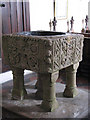 TL9594 : St Margaret's church - baptismal font by Evelyn Simak