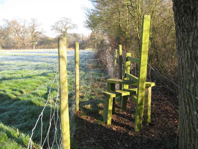 Burntcommon: Stile on footpath to Gambles Lane
