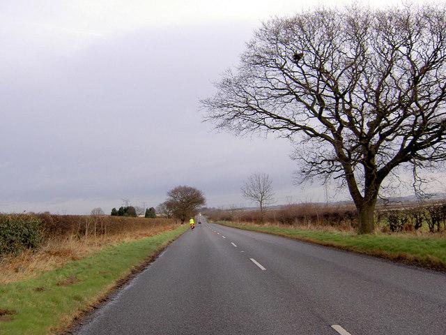 Long straight road near Upper Morton B6420
