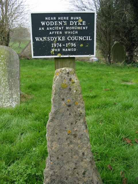 Sign and stone in Englishcombe churchyard