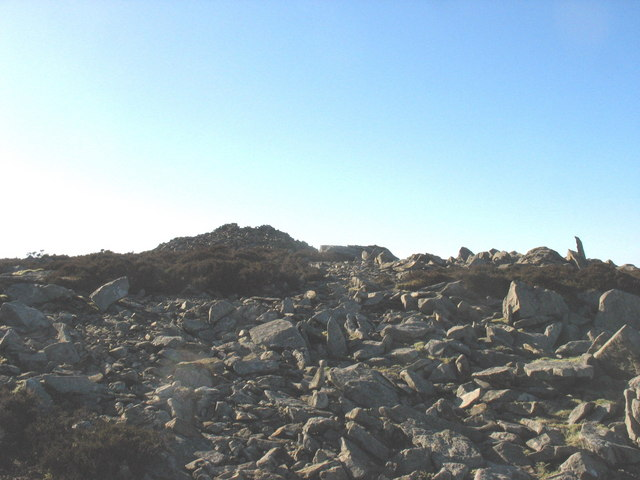 Approaching the summit cairn of central peak of Yr Eifl