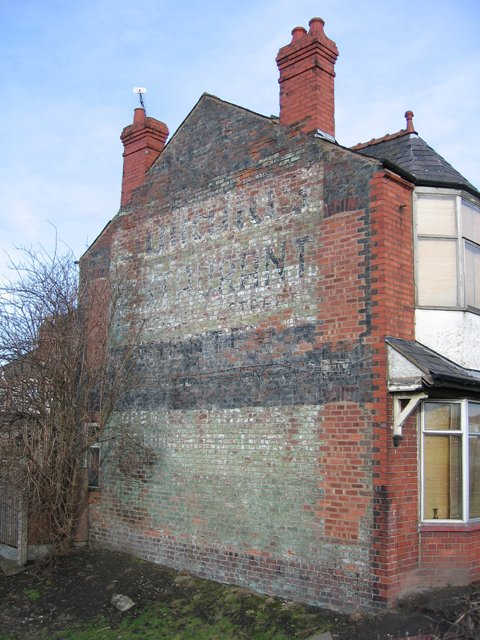 Faded advertising on house