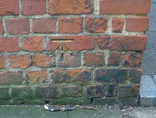 Benchmark cut in brick of Forbury gateway.