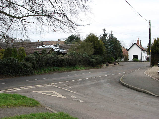 Junction of The Street with Carbrooke Road