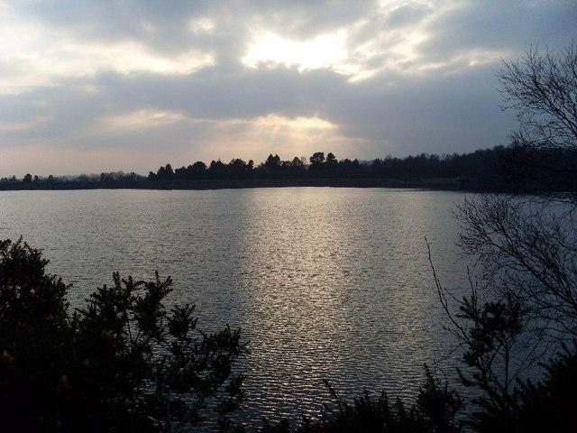Evening sun glints over Mugdock Reservoir