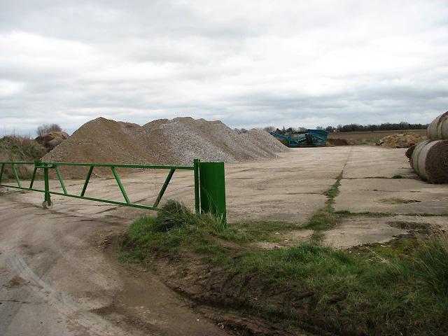 Concrete hardstand in field beside road