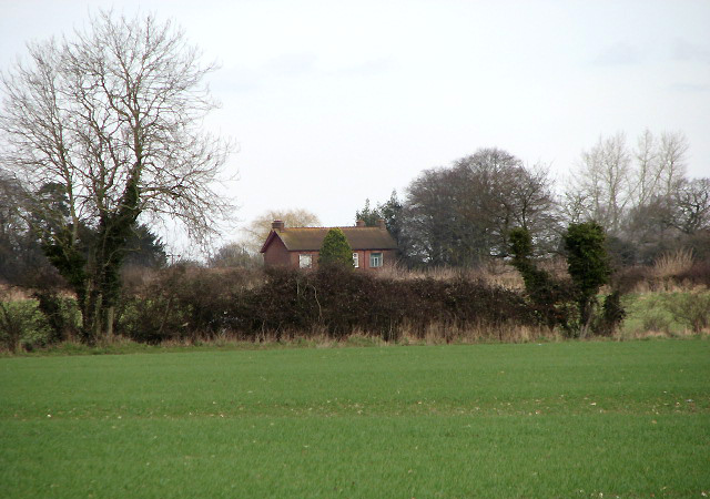 A house surrounded by fields
