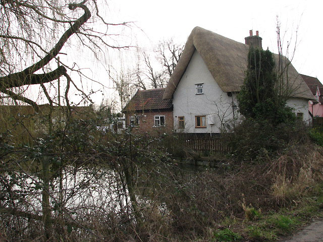 Thatched cottage and millpond