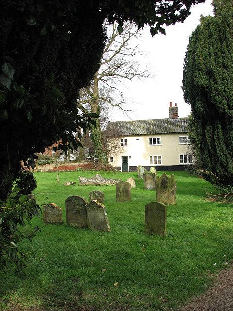 House bordering on churchyard