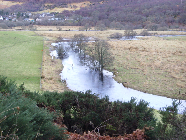 Flooded river, with Rogart in distance