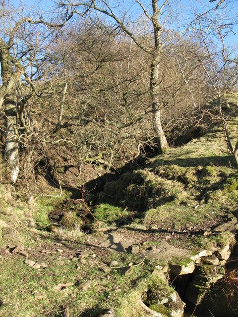 Stone slab bridge over the sike below Bates Hill