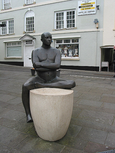 Boatman sculpture in bronze and stone by Andre Wallace