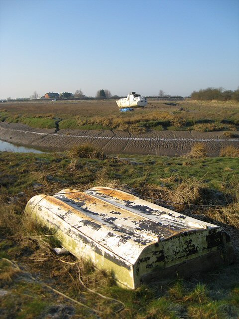 Beached boats on River Conder's banks