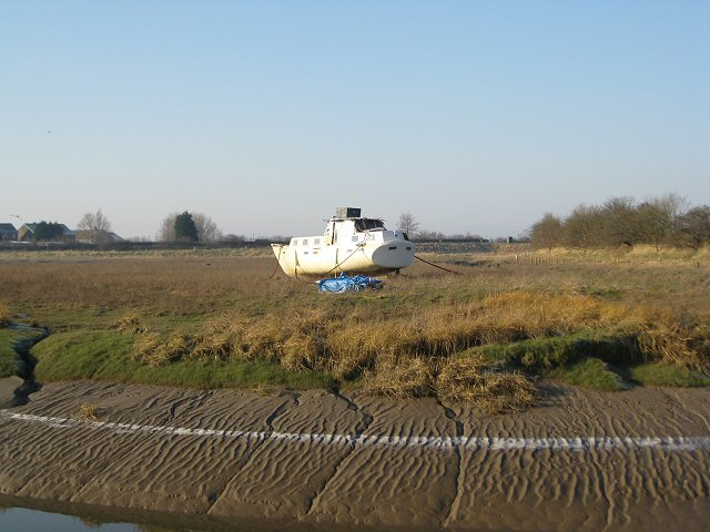 Beached boat on River Conder's banks