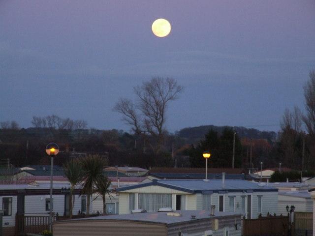 Full moon over caravan site, South Beach, Heacham