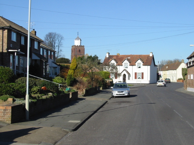 Looking NW along Manor Road, the B2056 at Upper Deal