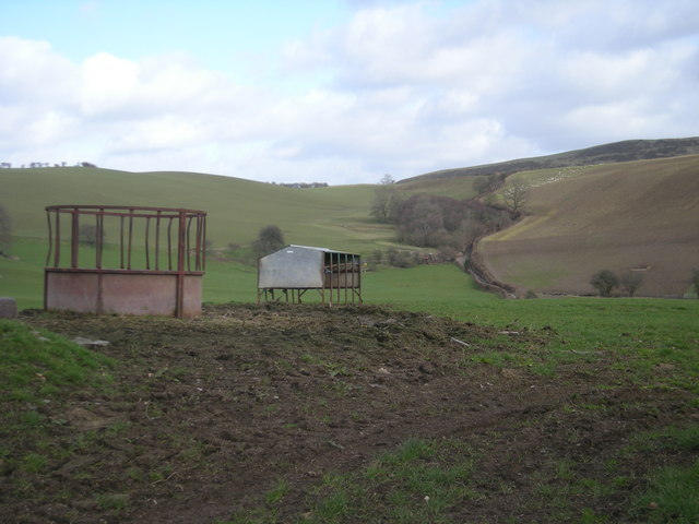 Hillside with livestock feeders