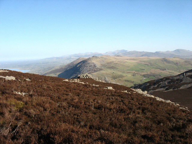 View north-eastwards across the heather-clad summit plateau of Yr Eifl