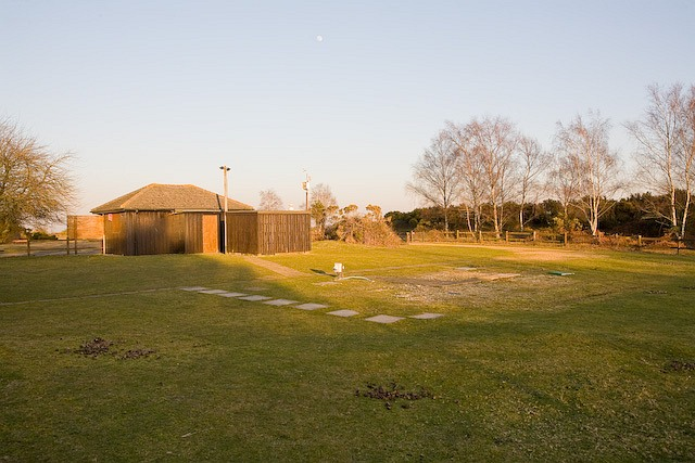Hut and clearing at Ocknell camp site, New Forest