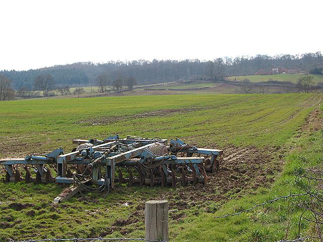 Farm machinery near Lyne Down