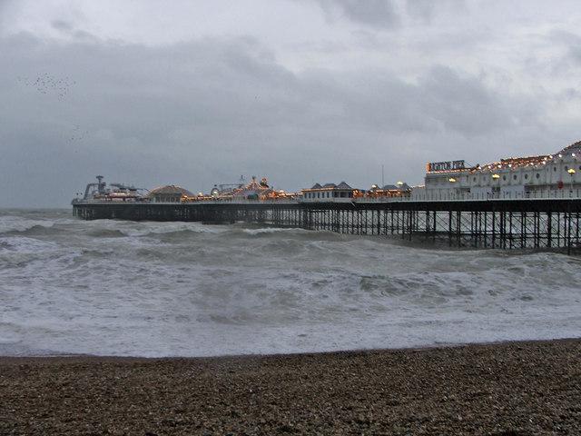 Brighton Pier, East Sussex, with rough sea