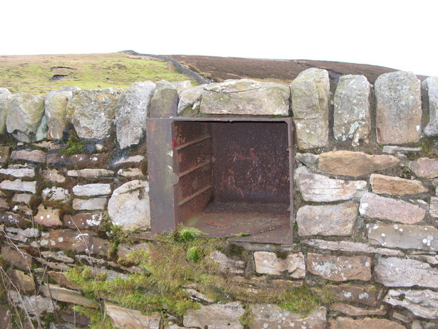 Oven from a cast iron range built into a wall in a sheepfold
