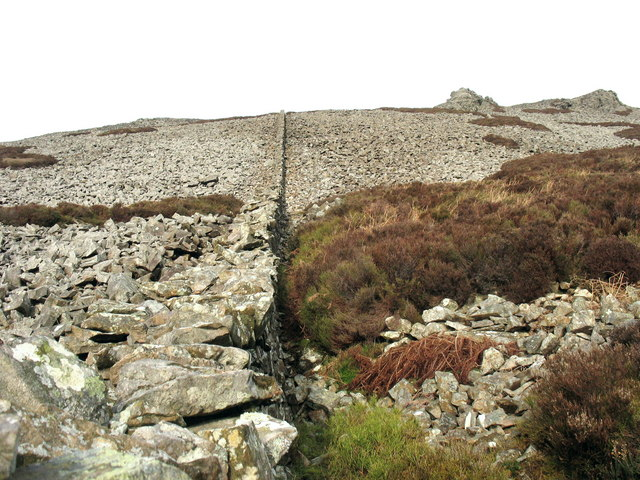 Farm boundary wall through the scree on the southern slopes of Tre'r Ceiri