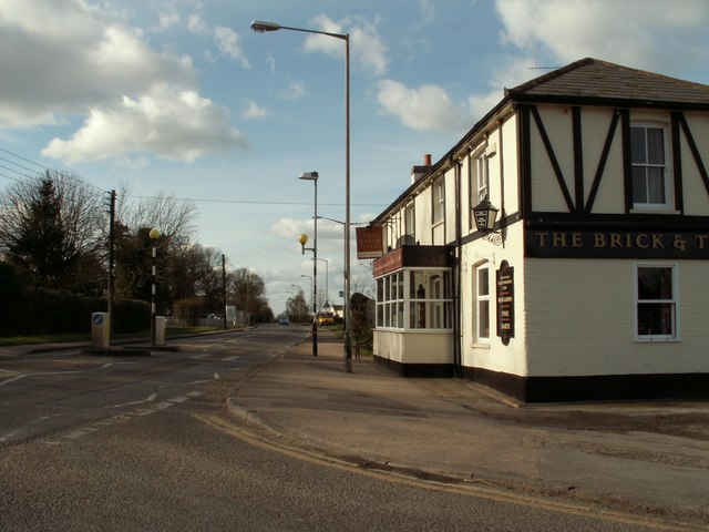 A road junction by The Brick & Tile public house