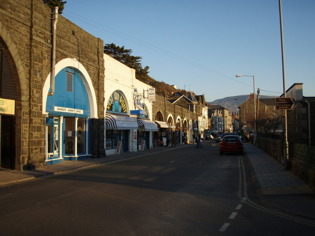 Arched shops in King Edward St, Barmouth.