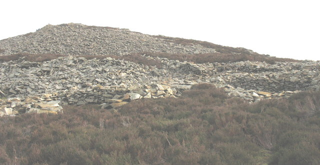 View across Iron Age hut circles towards the Bronze Age cairn