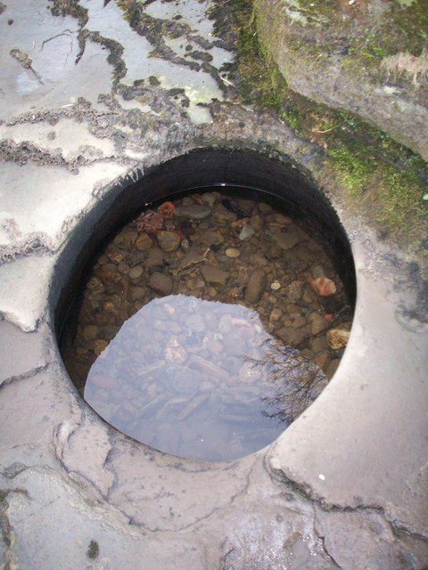 Hole in the river bank at Quakers Yard