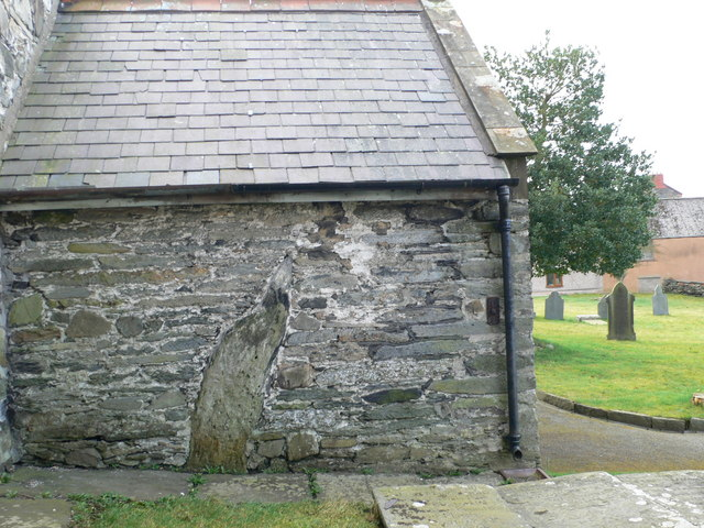 Standing stone incorporated into church porch