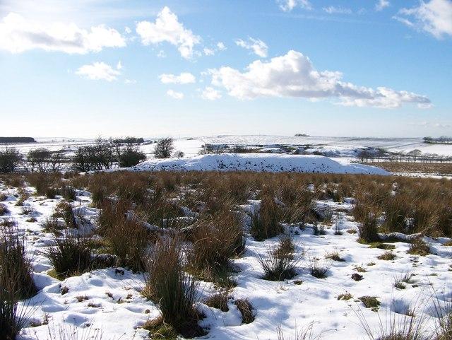 Snow covered quarry spoil heaps near Kilncadzow