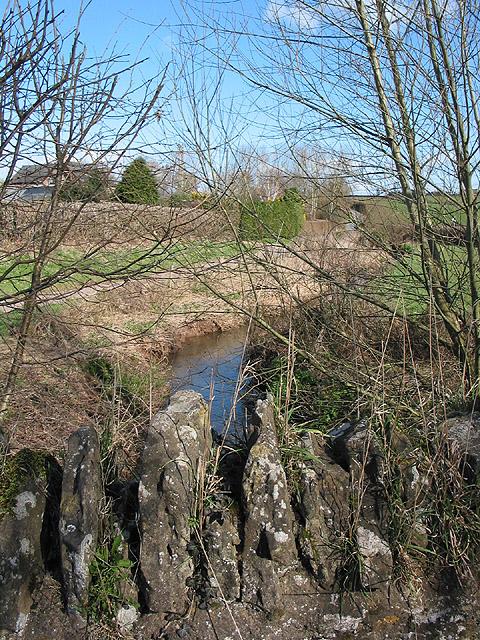 Gamber Brook passes between two roads